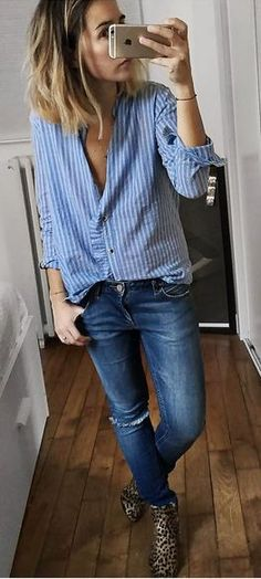Instagram Style | (@audreylombard): button-down shirt x blue denim x isabel marant leopard boots