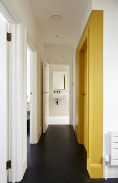 Dope painted wall feature and black floor Interior Design Inspiration, Color Inspiration, Yellow Accent Walls, Yellow Hallway, Mustard Walls, Accent Wall Bedroom, Black Floor, Yellow Area Rugs, Scandinavian Home