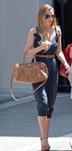blue jumpsuit, nude sandals, nude purse and aviator sunglasses