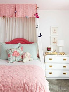 What child doesn't want a canopy bed? Homeowners made their little girl's wishes come true with a DIY valance bed canopy. The secret? It's a crib skirt! A string of butterflies emphasizes the canopy framing./
