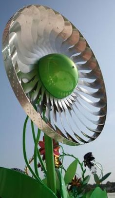 The Power Flower wind turbine design makes use of single piece of various metals tooled into a flower shape to capture wind power at just 2 miles per hour.