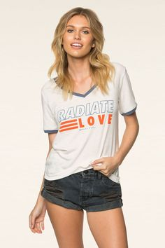 """Radiate love in the perfect retro v-neck ringer tee with contrasting trims and a relaxed, boyfriend fit. Made from ultra soft cotton / poly blend. Model is 5'8"""" and wearing size small. HO60418015"""