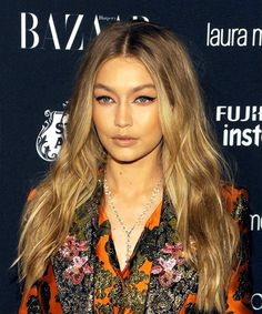 Gigi Hadid Long Soft Beachy Hairstyle.  Gigi Hadid has model facial features and a strong bone structure, which is nicely highlighted by her soft wavy tresses here. Having an oval face shape, Gigi has a short, broad forehead, high cheekbones and a rounded chin area. Voluminous hairstyles that have lots of body and volume around the face and neck area are ideal for her as they show off her face shape the best.