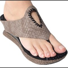 """Taupe Snake Optima Reversible Sandal. Hard to find. """"Unique shoes"""". Open to all offers, but please be considerate when offering, because these are brand new with box. Thanks.Unique sandals that you can reverse from taupe or change/reverse to Black. 2.5"""" heel with 1"""" platform. Upper: Taupe/Grey/Black. Insole:  Microsuede-Black. Platform:  Plaited Taupe straw. Man-made. Imported. Modzori Shoes"""