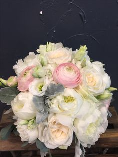 Lovely Bridal bouquet with ranunculus, O'hara roses, peonies, lisianthus, eucalyptus and silver leaves.