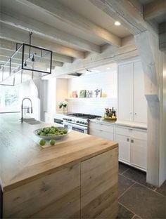 Modern Farmhouse: Beautiful wood & white kitchen...love the whitewashed beams and metal square light pendants.