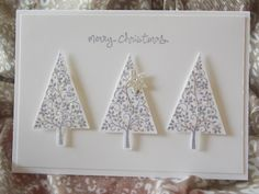 Stampin' Up! ... handmade Christmas card ... white ... three trees punched and popped up ... clean and simple ... lovely