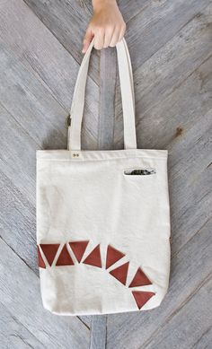 love it!  Geometric tote bag: Canvas with rose leather applique. $50.00, via Etsy.