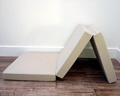 Tri-fold mattress.  from the same people who make boat mattresses (custom cushions & mattresses in weird shapes.)
