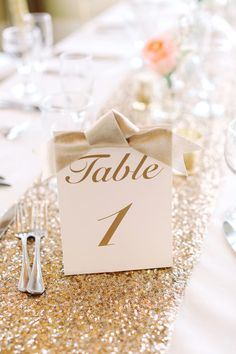 Glam gold table numbers: http://www.stylemepretty.com/new-jersey-weddings/2016/01/11/glamorous-private-estate-beach-wedding/ | Photography: Kay English - http://www.kayenglishphotography.com/
