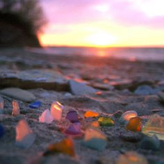 Sea glass used to be called beach glass.  Finding a piece is a wonderful treasure.  Walking along a beach or shore looking for bits of sparkle or color or shell or rock or glass is a wonderful way to spend time and find little treasures to take home.
