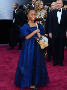 Quvenzhane Wallis -9 year old Oscar nominee - with a puppy purse! Adorbs!