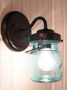 A blue Ball Mason jar moonlights as a handcrafted sconce lamp.