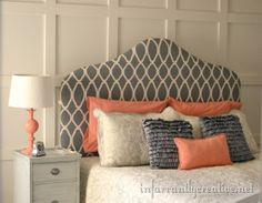coral and gray bedroom with a DIY stenciled upholstered headboard.