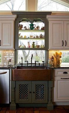 Cooking implements, appliances and storage are also important facets of farmhouse kitchen design. Sinks have a special place in farmhouse kitchen design. The classic farmhouse sink features a deep, wide basin often made of porcelain or stainless steel; Rustic Kitchen Sinks, Kitchen Sink Decor, Copper Farmhouse Sinks, Green Kitchen Cabinets, Kitchen Cabinet Styles, Farmhouse Kitchen Cabinets, Farmhouse Style Kitchen, New Kitchen, Copper Sinks