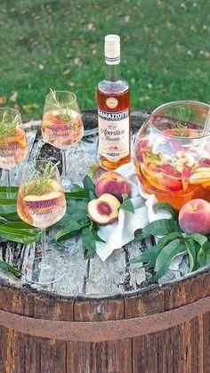 Sommerliche erfrischend fruchtige Pfirisch Bowle fuer die Sommerparty von Sweets and Lifestyle