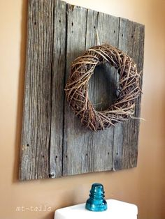 **1**Bathroom wreath on rustic wood panel above the toillet....Fall is bringing the changes.....