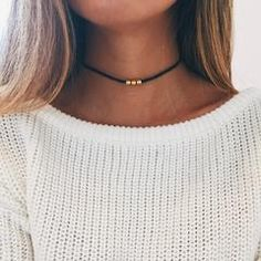 """Simple antique gold tibetan triple bead on a 12-14.5"""" cotton choker with an adjustable hook for closure."""