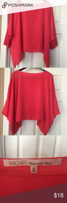 Coral oversized pheasant top This is a Rachel Roy oversized top. Very flowey and goes great with jeans! The color is a beautiful coral. It has a wide neck area so it shows off your neckline. It is super cute on. I have only worn it once. It is like brand new. It has been in my closet for too long and needs a good home. RACHEL Rachel Roy Tops Blouses
