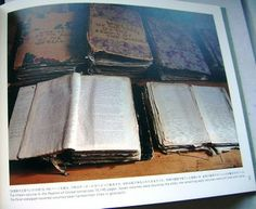 Excerpt from book, HENRY DARGER'S ROOM. Some original manuscripts of Realms. Some of them were bound by the artist; the rest are tied with twine.