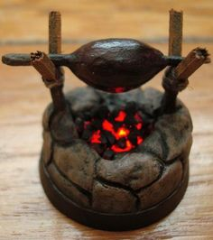 A glowing cook fire for your next DnD rpg session or wargaming camp raid.