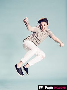 """Trevor Moran definitely isn't kidding when he says """"I Wanna Fly"""" – he managed to get some serious air inside the PEOPLE/EW photo booth at #VidCon.   Image Credit: Ramona Rosales/People/EW"""