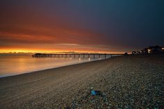 The sunrise was good for all 15mins before it just became gloomy rain and cloud. ///// #deal #pier #kent #uk #england #beach #sunrise #coast #water #sea #sun #clouds #landscape #longexposure #red #yellow #gold #warm #lights #stones #sonya6000 #samyang #captureonepro #photoshop #nisi #nd #ndreversegrad #every3secondsadonkeycries
