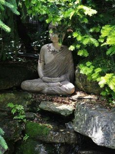 A meditation Buddha sits with its legs crossed in a single Lotus position. A symbol of peace and calm, the Buddha's eyes are closed. Its thumbs and the finger tips touch forming an oval symbolizing the turning of attention inward. Meditation Corner, Meditation Garden, Zen Garden Design, Garden Art, Buddha Zen, Buddha Buddhism, Pond Waterfall, Back Gardens, Wood Gardens