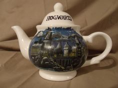 Hogwarts tea set - OMG I so WANT this!! I need someone to paint this for me!!