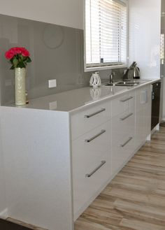 Waterfall edge with a laminate bench top - can be a more cost effective option to stone or granite but still looks great.