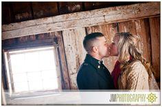 Winter Wedding Photography | Inn at Pleasant Lake | Bride & Groom Kiss | Vintage Barn Architecture | New Hampshire