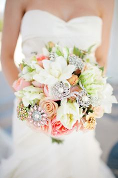 Glittering brooch & floral bouquet! Photography by table4weddings.com / Floral design by fantasyfloraldesigns.com