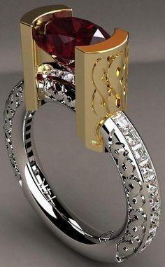 """Inelul """"Infinity"""" creat de către americanul Greg Neeley având montate în aur alb şi galben 14K un zircon roşu cu greutatea 4,85 carate şi 27 diamante incolore tăiate princess."""