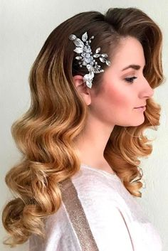 Our photo gallery featuring prom hairstyles down is waiting for your attention. Check it out in order to pick the most fabulous hairstyle for your prom.