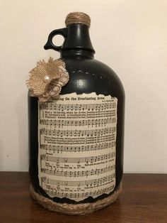 With sheet Hymn music. Painted Glass Bottles, Glass Jug, Bottles And Jars, Wine Jug Crafts, Mason Jar Crafts, Mason Jars, Recycled Wine Bottles, Wine Bottle Corks, Advent