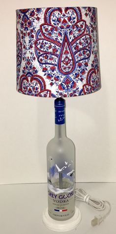 A personal favorite from my Etsy shop https://www.etsy.com/listing/499640583/repurposed-grey-goose-vodka-lamp