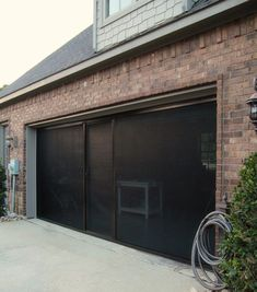 Garage door fly screen, such a good idea for the summer! These fit underneath the roller doors and would be perfect to have with the carport overhead. I could open up the garage all year around.