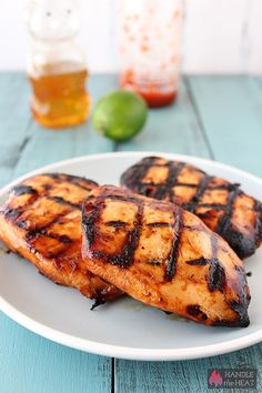 Honey Lime Sriracha Chicken  ingredients: 1/4 cup honey 3 tablespoons low-sodium soy sauce 1 tablespoon olive oil Zest and juice of two limes 3 garlic cloves, peeled 2 tablespoons Sriracha sauce 1 teaspoon kosher salt 4 boneless skinless chicken breast halves (about 6 ounces each)  Let marinade for at least four hours or overnight.   grill for direct cooking over medium heat (350°F to 450°F).