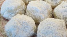Light, crunchy, round, buttery balls, with chopped nuts in them, coated with confectioner's sugar. These look nice when placed on a tray in the mini paper cupcake liners.