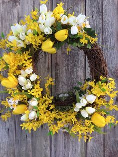 This yellow Forsythia Grapevine Wreath will make a beautiful addition to any door! This wreaths says, Goodbye Winter and Hello Sunshine! :-)