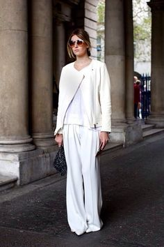 Shop this look for $69:  http://lookastic.com/women/looks/biker-jacket-and-crew-neck-t-shirt-and-dress-pants-and-pumps-and-clutch/2919  — White Leather Biker Jacket  — White Crew-neck T-shirt  — White Dress Pants  — White Leather Pumps  — Black Sequin Clutch