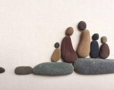 Family of five pebble picture by sharon nowlan