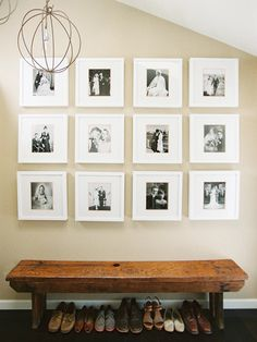 gallery wall with white frames and black and white family photos.