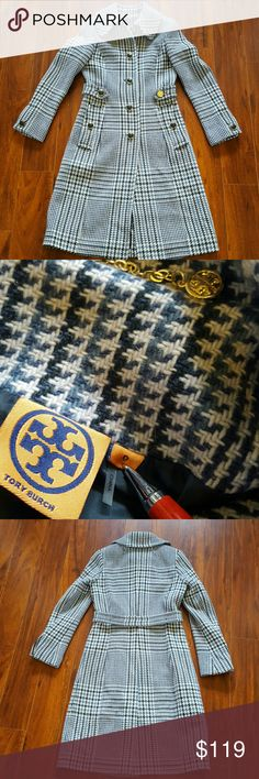 TORY BURCH Virginia Houndstooth Coat Lovely wool/rayon/poly Virginia Hounds tooth Coat in blue. Item #581580. Beautiful preloved shape, but one flaw, missing leather cap on button at belt (see pic 4). I contacted TB, but they do not offer replacements. If I were keeping this treasure I would replace the buttons at the cuffs with gold buttons, and use one to replace the missing one. Front button closure, buttoned cuffs, side faux flap pockets, back half belt, fully lined, dry clean. Love it…
