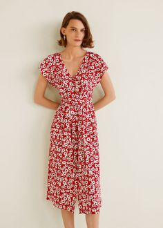 Straight design Flowy fabric Flowers print V-neck Short sleeve Side pockets Bow on the waist Button fastening on the front section