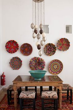Love this!! You don't need a lot of room, the table is versatile, and so lovely. You would put Turkish bowls on the walls.
