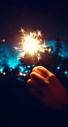 Happy New Year Fireworks Hand iPhone 6 Plus HD Wallpaper