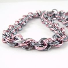 Spiral Weave Chainmail Necklace in Pink and Black Ice . . . I suggest clicking though to this person's page and checking out a lot of gorgeous color combinations of chainmaille.