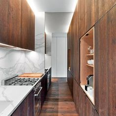 White oak cabinetry contrasts with honed Calacatta gold marble in this Manhattan factory loft kitchen by Messana O'Rorke. : Eric Laignel. #architecture #interiors #design #interiordesign #apartment #nyc #kitchen @messanaororke... - Interior Design Ideas, Interior Decor and Designs, Home Design Inspiration, Room Design Ideas, Interior Decorating, Furniture And Accessories