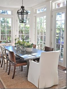 My dream for our kitchen table corner. Change the windows to doors with panes and windows in overhead transom.